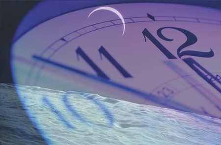 Ocean and moon behind clock reaching midnight