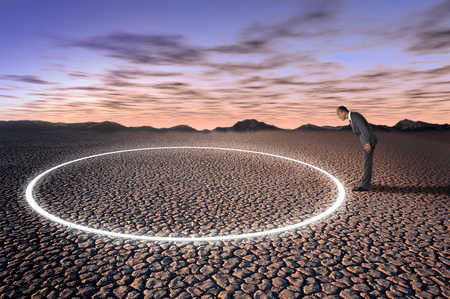 Businessman Looking At Circle In The Desert