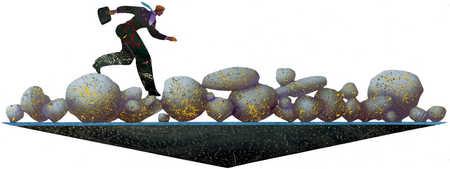 Businessman running on rocks while balancing