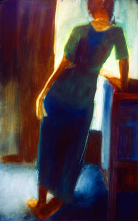 Woman leaning on a piece of furniture