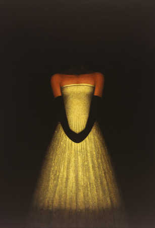 Woman in formal dress with head blacked out