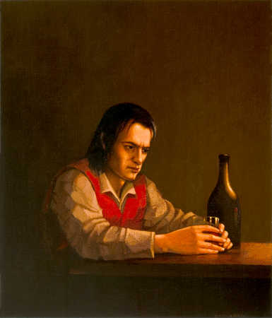 Depressed man holds a glass of wine