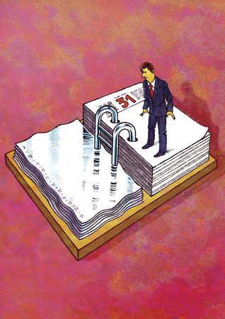 Businessman standing on calender