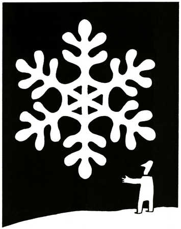 Man gazing at oversized snowflake