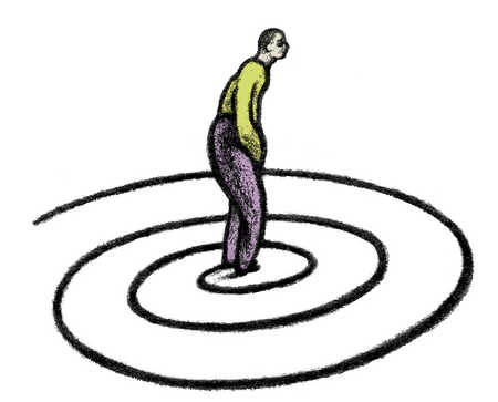 Man standing in middle of spiral
