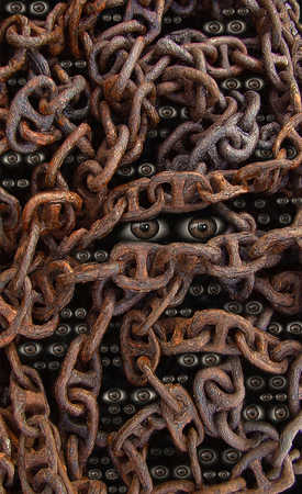 Eyes looking through chains