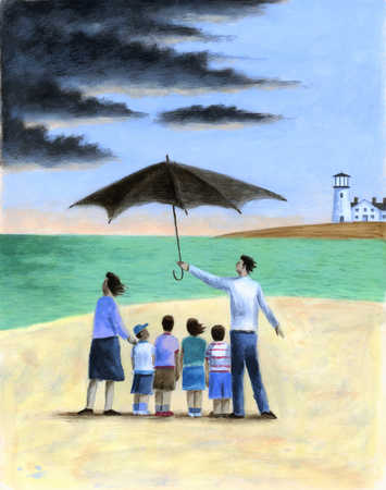 Father holding umbrella over family