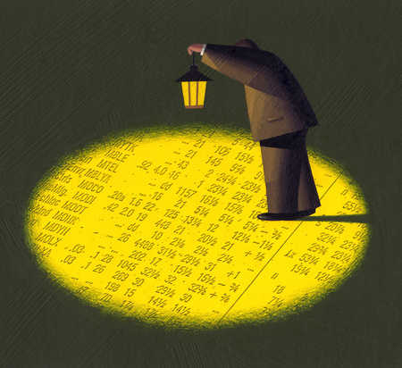 Businessman shining lantern over financial page