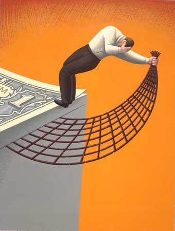 Businessman holding net on edge of money stack