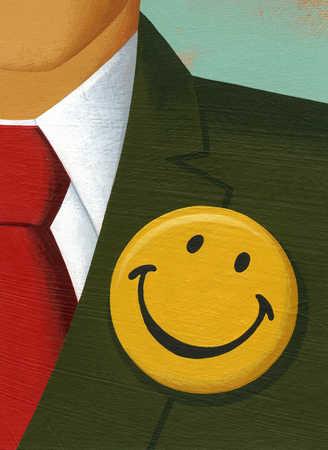 Happy face button on businessman's lapel