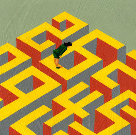 Businesswoman looking down into maze