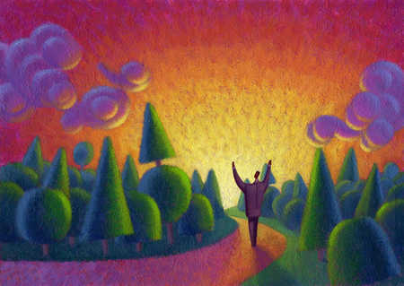 Businessman with arms raised at sunrise