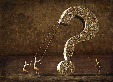 People raising stone question mark