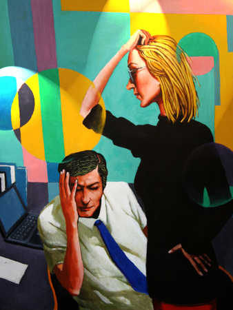 Businessman and woman with head in hands