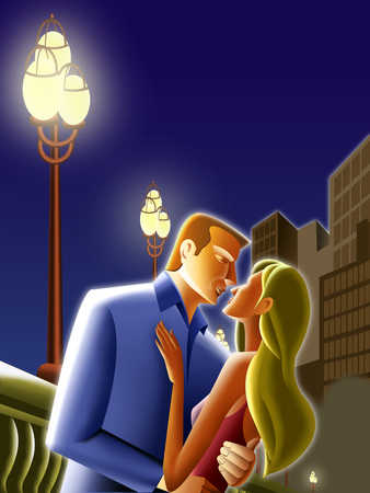 Young couple standing in street light