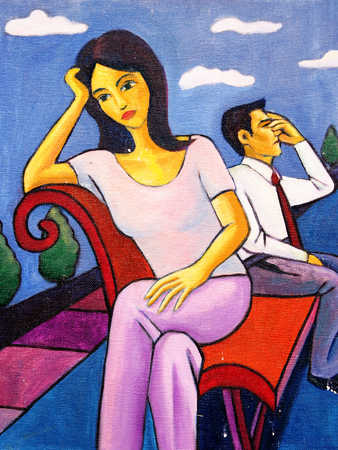 Young couple sitting in park with head in hands