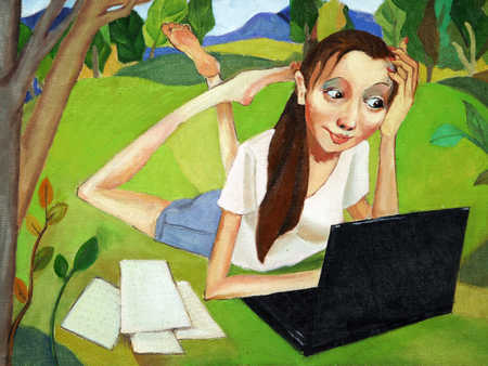 Young woman lying on grass, using laptop