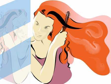 woman brushing her long red hair