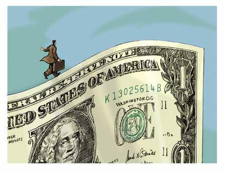 businessman walking on the edge of a dollar bill