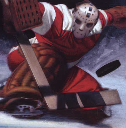 Goaltender stopping a puck in hockey