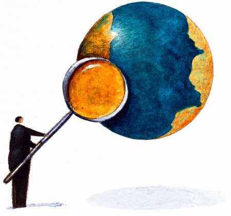 Man Magnifying Part Of Globe