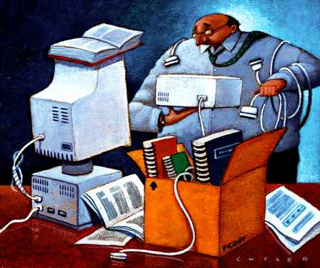Man With Computer Hardware And Manuals