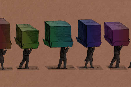 Businesspeople walking beneath multicolored cardboard boxes