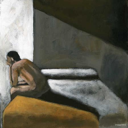 Depressed man sitting in dark room