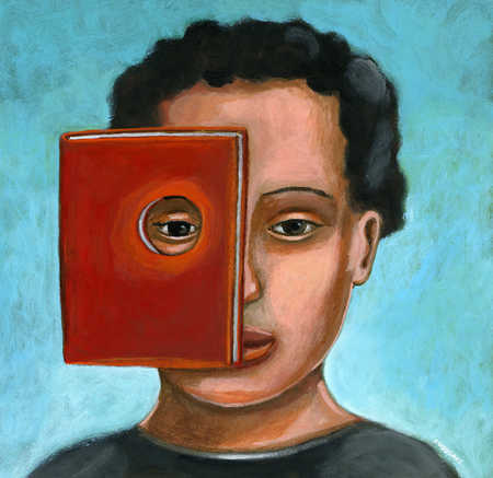 Boy looking through hole in book