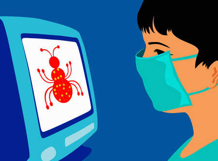Boy in surgical mask looking at computer virus