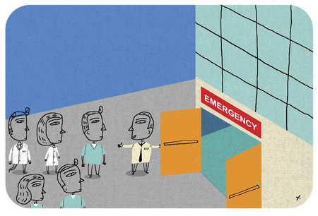 Man opening doors to emergency room for doctors