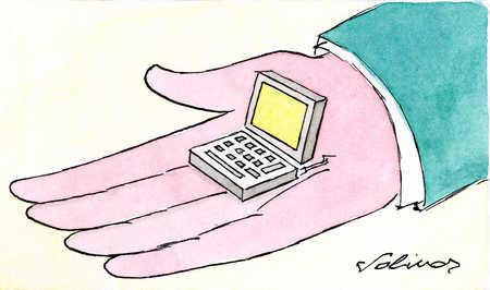 Man's hand holding tiny computer
