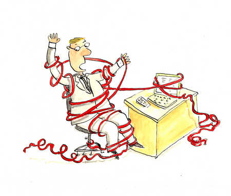 A businessman tied up in red tape.