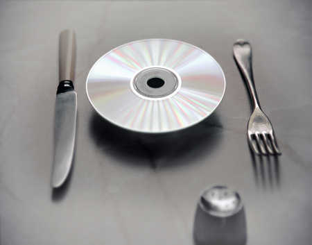 CD with knife and fork on table
