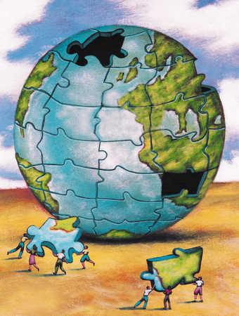 People assembling globe puzzle
