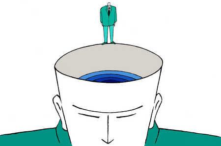 Businessman looking down inside man's head