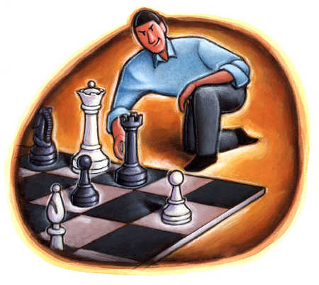 Man moving chess piece on chessboard