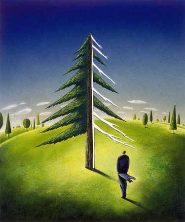 Businessman standing under tree