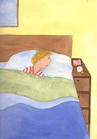 Boy laying in bed looking at alarm clock
