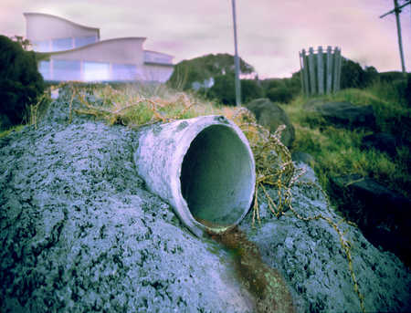 Drainpipe with building in background