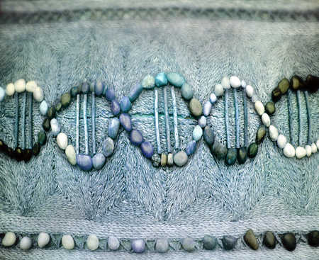 Colored stones and sticks forming DNA helix symbol, close-up