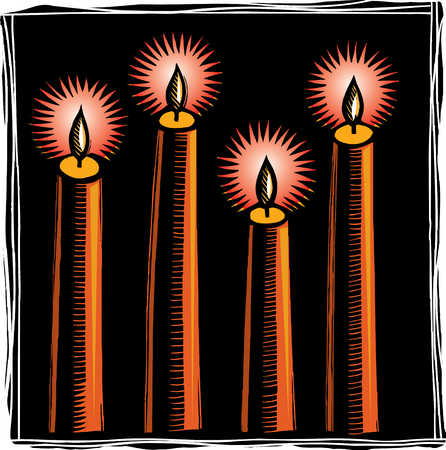 Close up of four candles burning