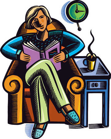 Woman in armchair reading book