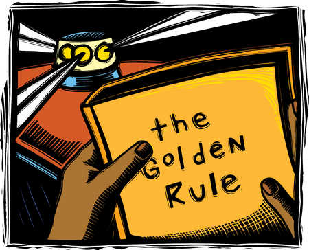 Close up of hands holding book with title, 'The Golden Rule'