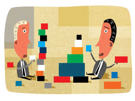 Businessmen stacking colored blocks