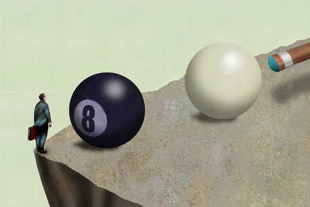 Businessman on edge of cliff facing eight ball