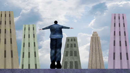 Businessman jumping from ledge among high-rise buildings