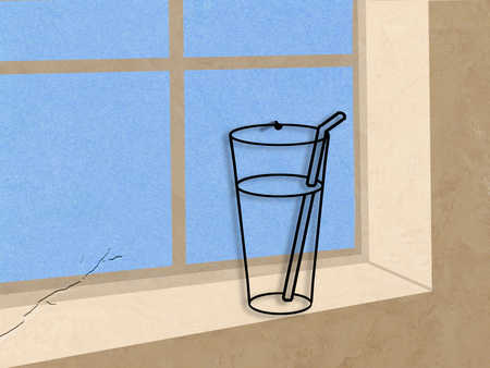 Water glass with straw on window ledge