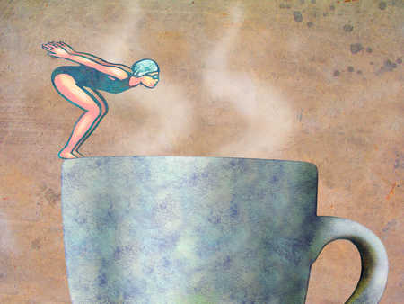 Female swimmer diving into coffee cup