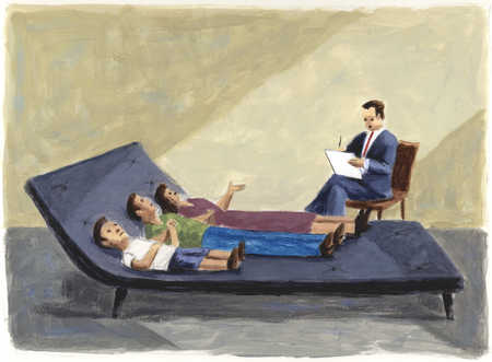 Couple and son laying on large chaise lounge in psychiatrist's office